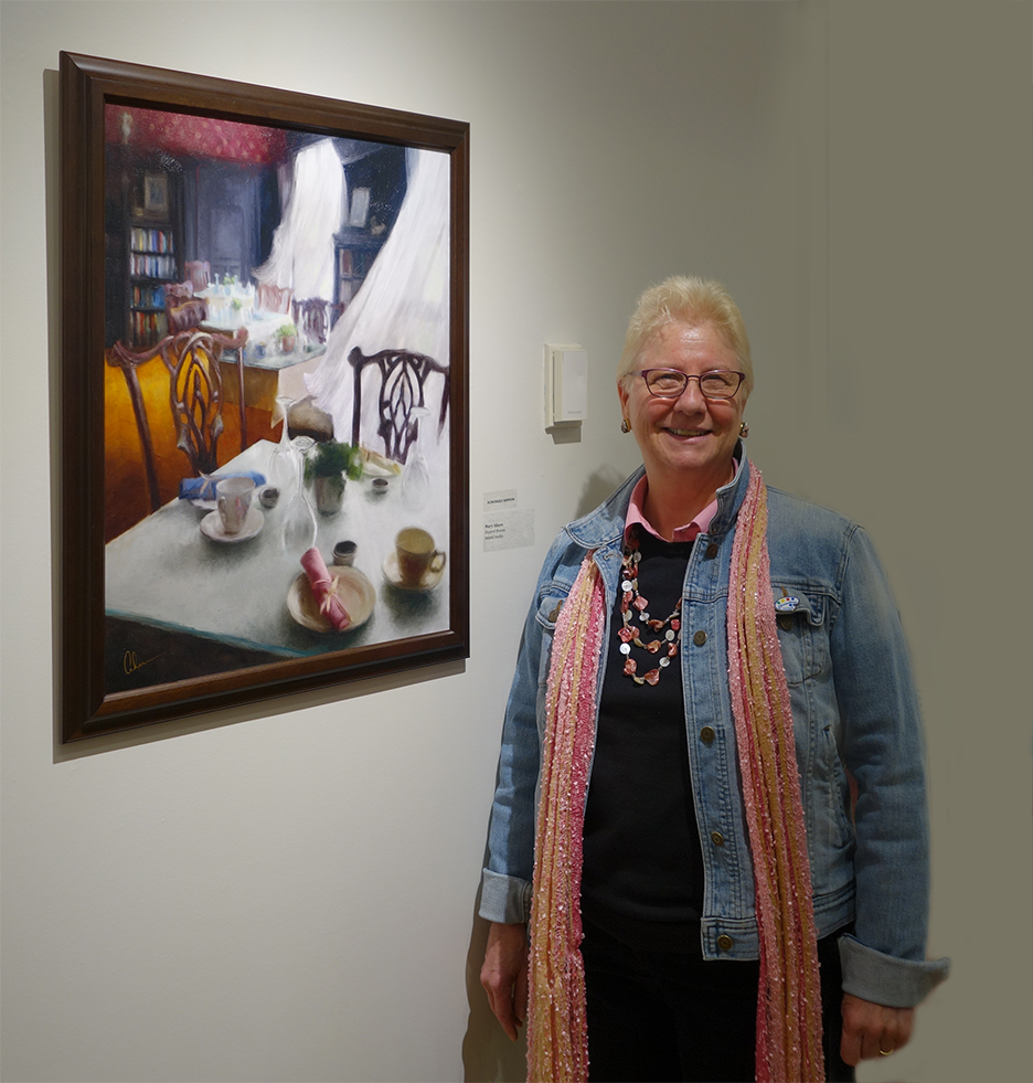 "Mary Ahern with her Award-Winning Painting, ""Bayard Breezes"""